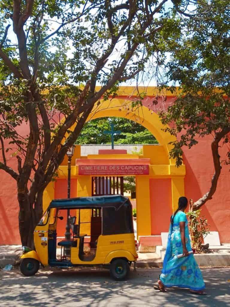 Woman in blue saree walking through Pondicherry